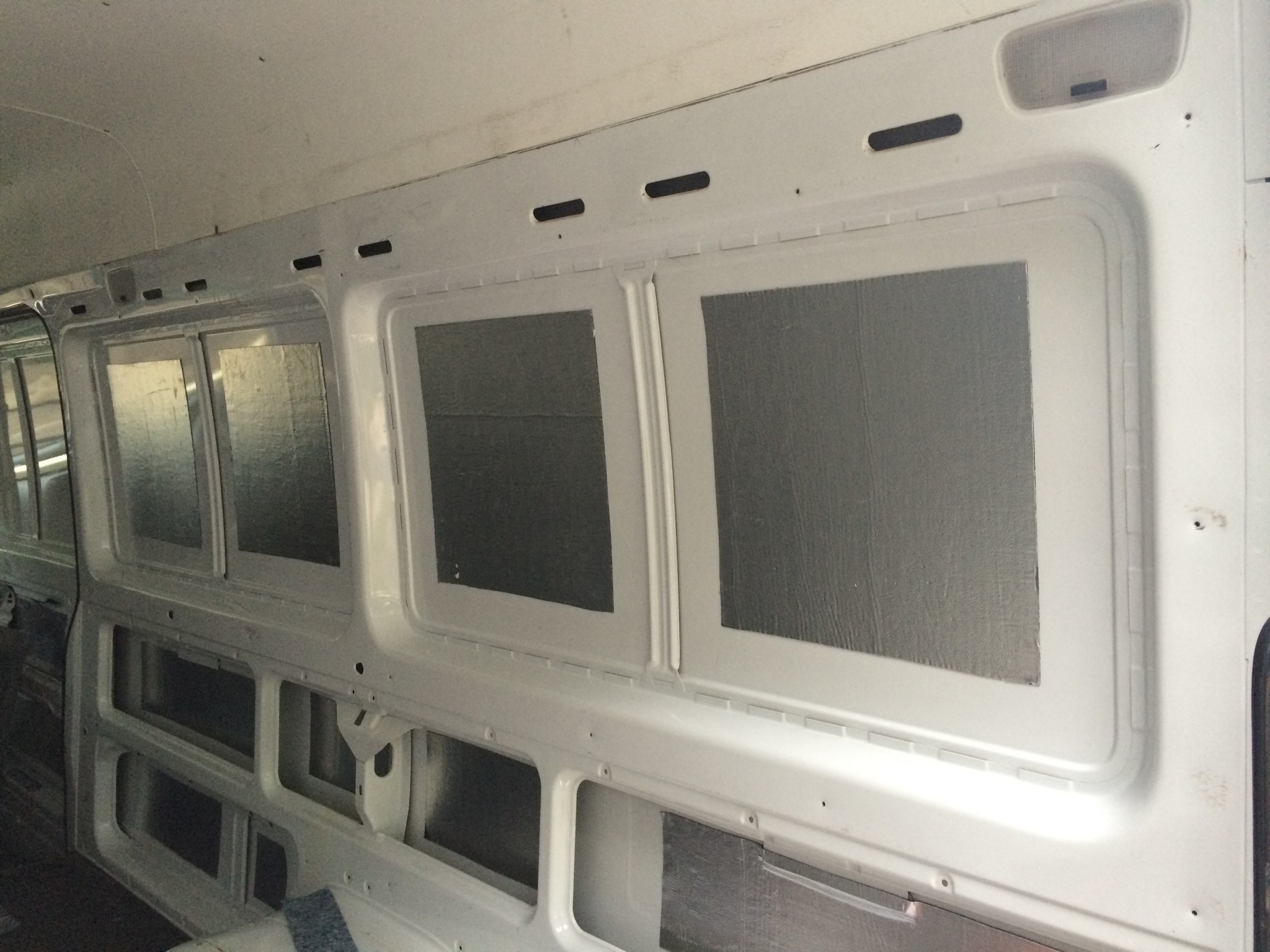 Butyl Tiles On The Sheet Metal Panels Of A Sprinter Van