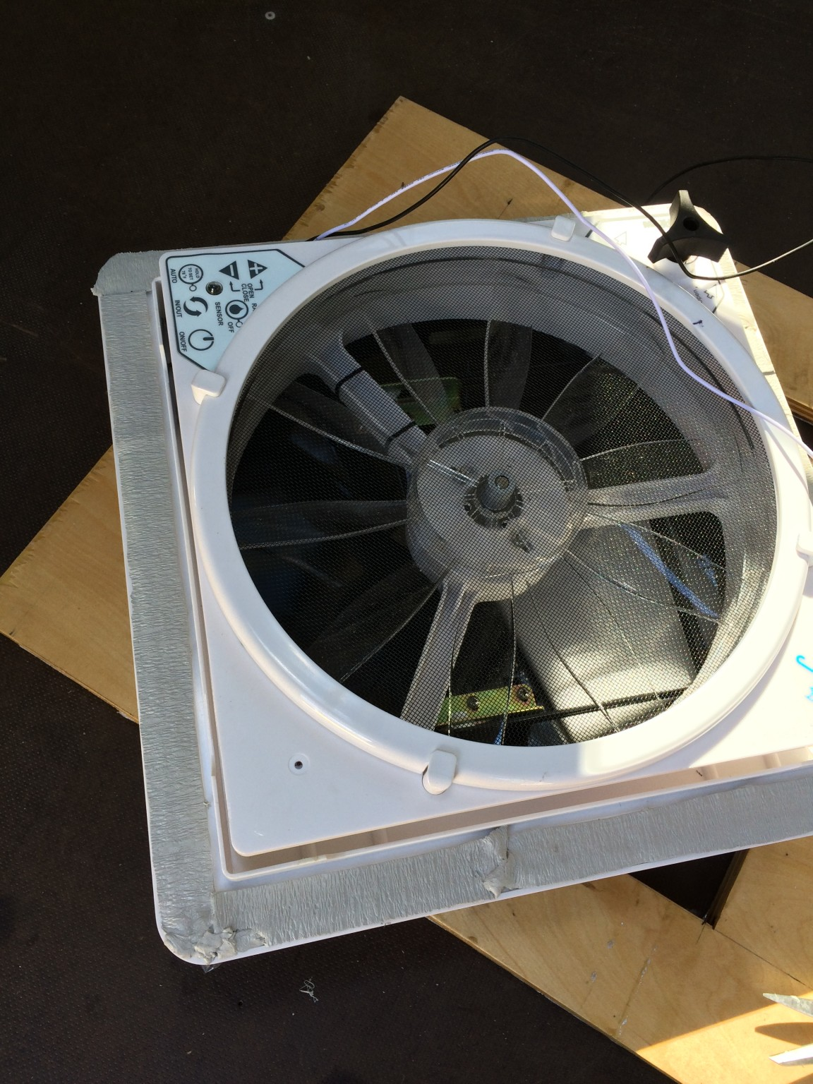 Sealing the roof fan with putty tape