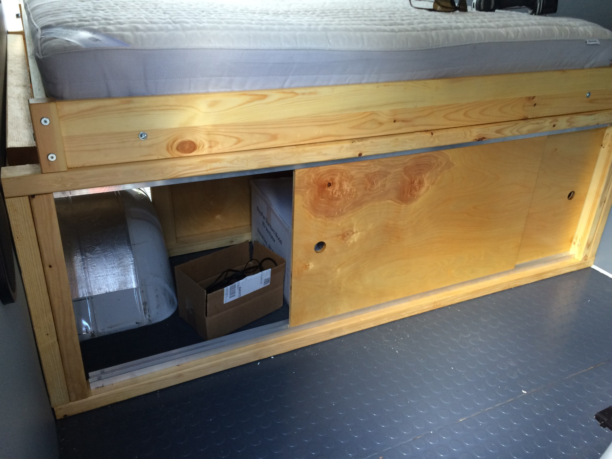 Bed base with sliding doors for the storage area