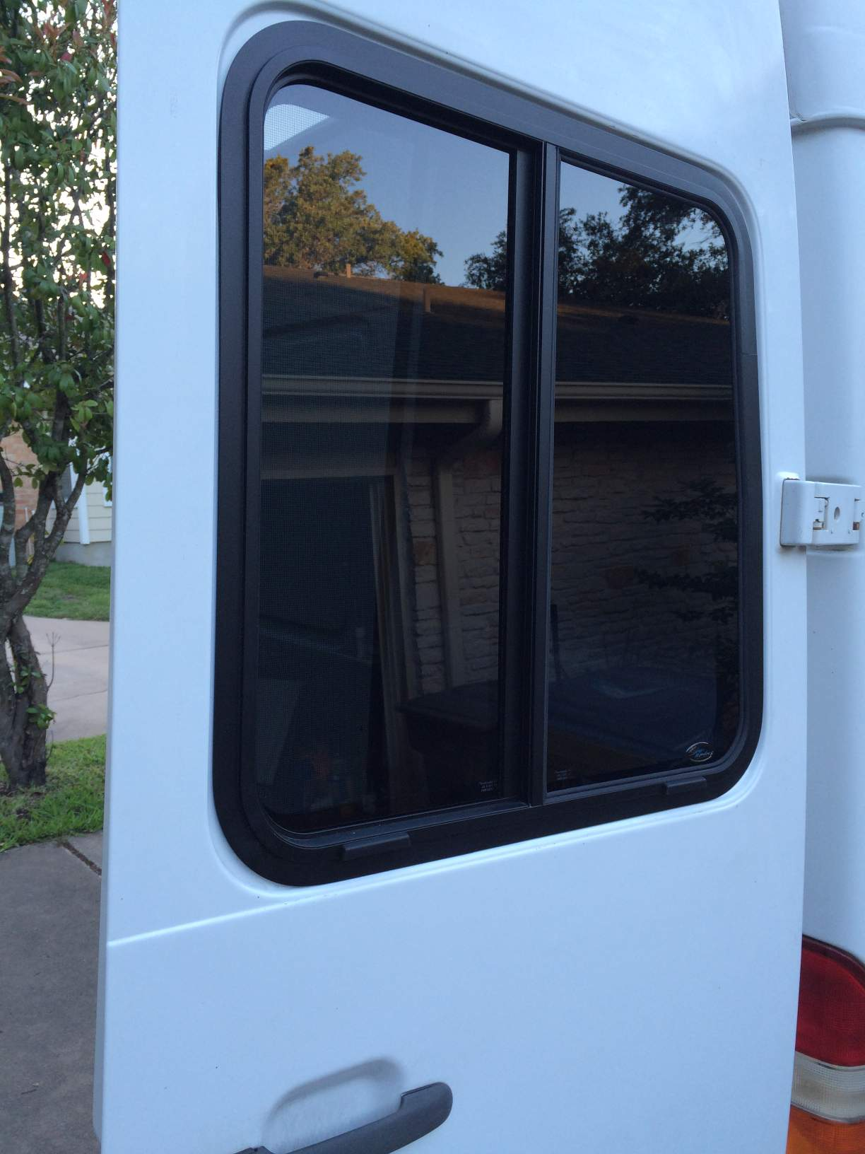 Sliding windows for the rear doors sprinter camper for Sliding doors and windows